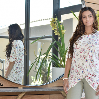the model wears the PerryWinkle nursing blouse in a delicate floral print